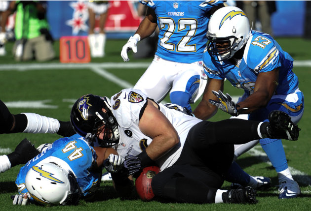 Baltimore Ravens guard Gino Gradkowski, center, recovers their own fumble away from San Diego Chargers' Jackie Battle, left, during the first half of an NFL football game, Sunday, Nov. 25, 2012, i