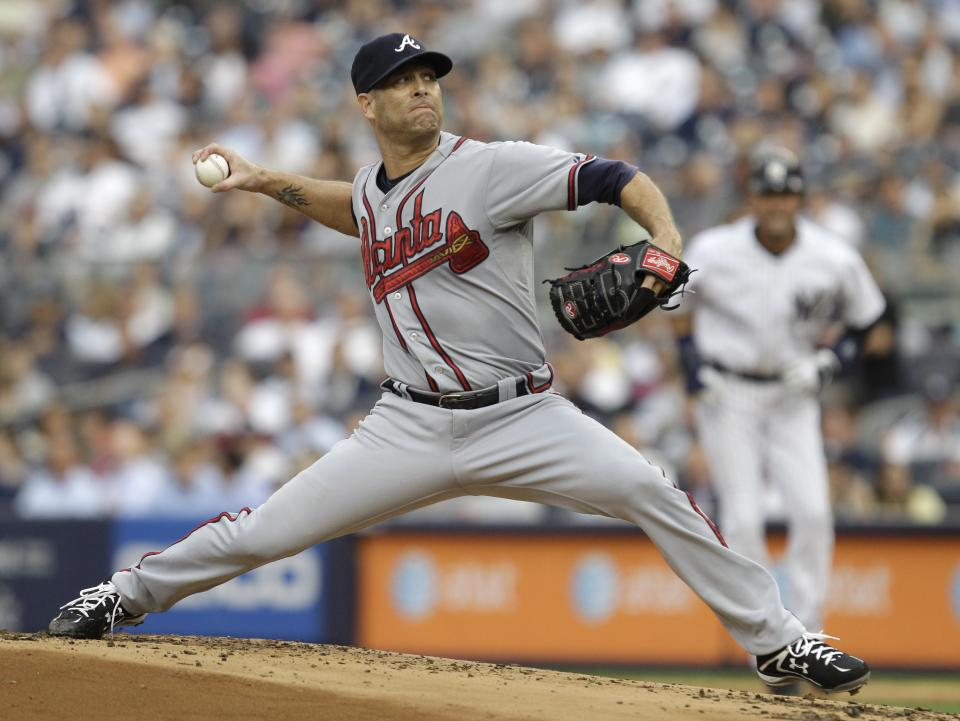 Atlanta Braves pitcher Tim Hudson works in the first inning of the Braves' baseball game against the New York Yankees at Yankee Stadium in New York, Tuesday, June 19, 2012. Yankees' Derek Jeter takes a lead at first in the background. (AP Photo/Kathy Willens)