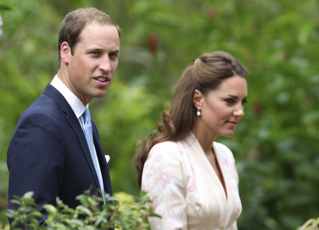 Prince William and his wife Kate, Duke and Duchess of Cambridge, tour the Orchid Garden within the Singapore Botanical Gardens in Singapore on Tuesday, Sept. 11, 2012. The British royal couple is on a