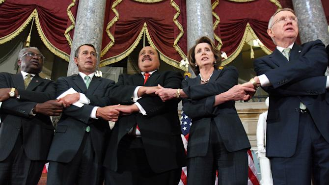 """FILE - In this Thursday, April 3, 2008 file photo, from left, House Majority Whip James Clyburn of South Carolina, House Minority Leader John Boehner, of Ohio, Martin Luther King III, House Speaker Nancy Pelosi, of California, and Senate Majority Leader Harry Reid, of Nevada, hold hands as they sing """"We Shall Overcome"""" in Statuary Hall on Capitol Hill in Washington as House and Senate leaders held a ceremony to honor the Rev. Martin Luther King Jr. the day before the 40th anniversary of his death. (AP Photo/Lauren Victoria Burke, File)"""