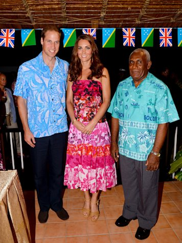 Britain's Prince William, left, and wife Kate, the Duchess of Cambridge, center, pose for a photo with His Excellency the Governor General of the Solomon Islands, Sir Frank Kabui, in Honiara Sunday Sept. 16, 2012. The royal couple is on a nine-day tour of the Far East and South Pacific in celebration of Queen Elizabeth II's Diamond Jubilee. (AP Photo/William West, Pool)
