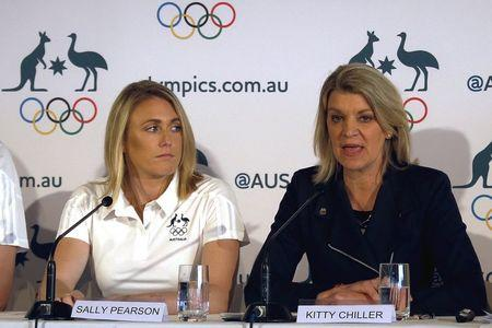 Australia's Olympic 100 metres hurdles champion Sally Pearson listens to Australia's chef de mission Kitty Chiller as she speaks during a media conference in Sydney, Australia