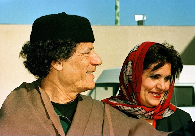 Gadhafi and wife