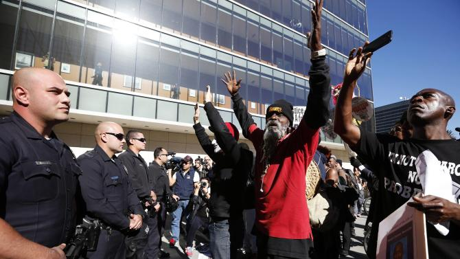 People protest against the killing of a homeless man by police outside LAPD headquarters in Los Angeles