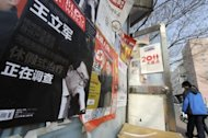 <p>A poster of Wang Lijun alongside a street in Beijing in February. A top official at the centre of the biggest political scandals in China in decades has resigned from his parliamentary post, state press say</p>