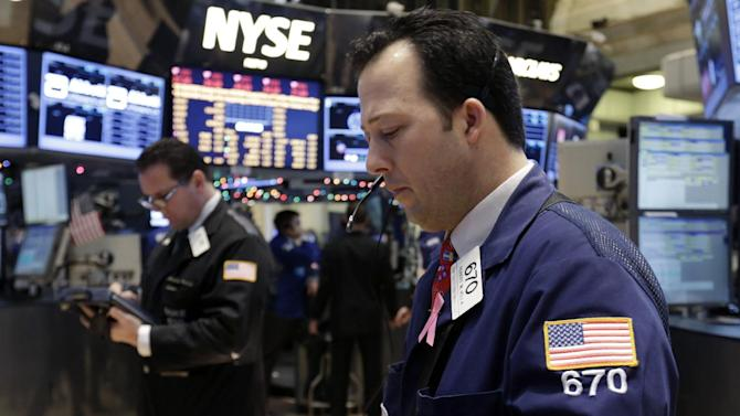 "In this Friday, Dec. 14, 2012, photo, trader Robert Vella, right, works on the floor of the New York Stock Exchange. Stocks edged higher on Wall Street amid optimism that the lawmakers in Washington are closing in on a budget deal that will stop the U.S. going over the ""fiscal cliff.""  (AP Photo/Richard Drew)"