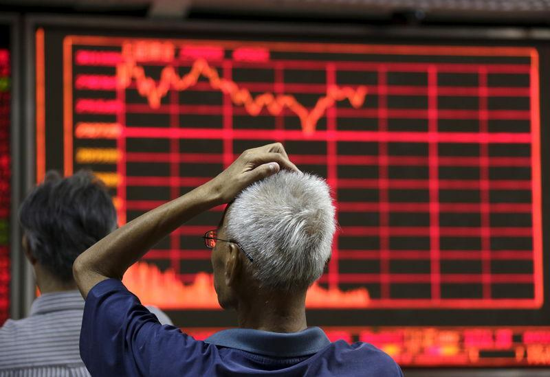 China state media announce confessions in stock market investigations