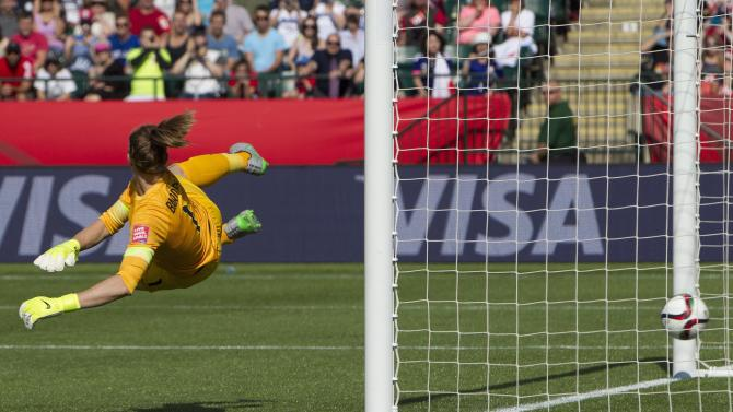England keeper Karen Bardsley lets in a goal on a penalty kick by Japan's Aya Miyama during the first half of a semifinal in the FIFA Women's World Cup soccer tournament, Wednesday, July 1, 2015, in Edmonton, Alberta, Canada. (Jason Franson/The Canadian Press via AP)