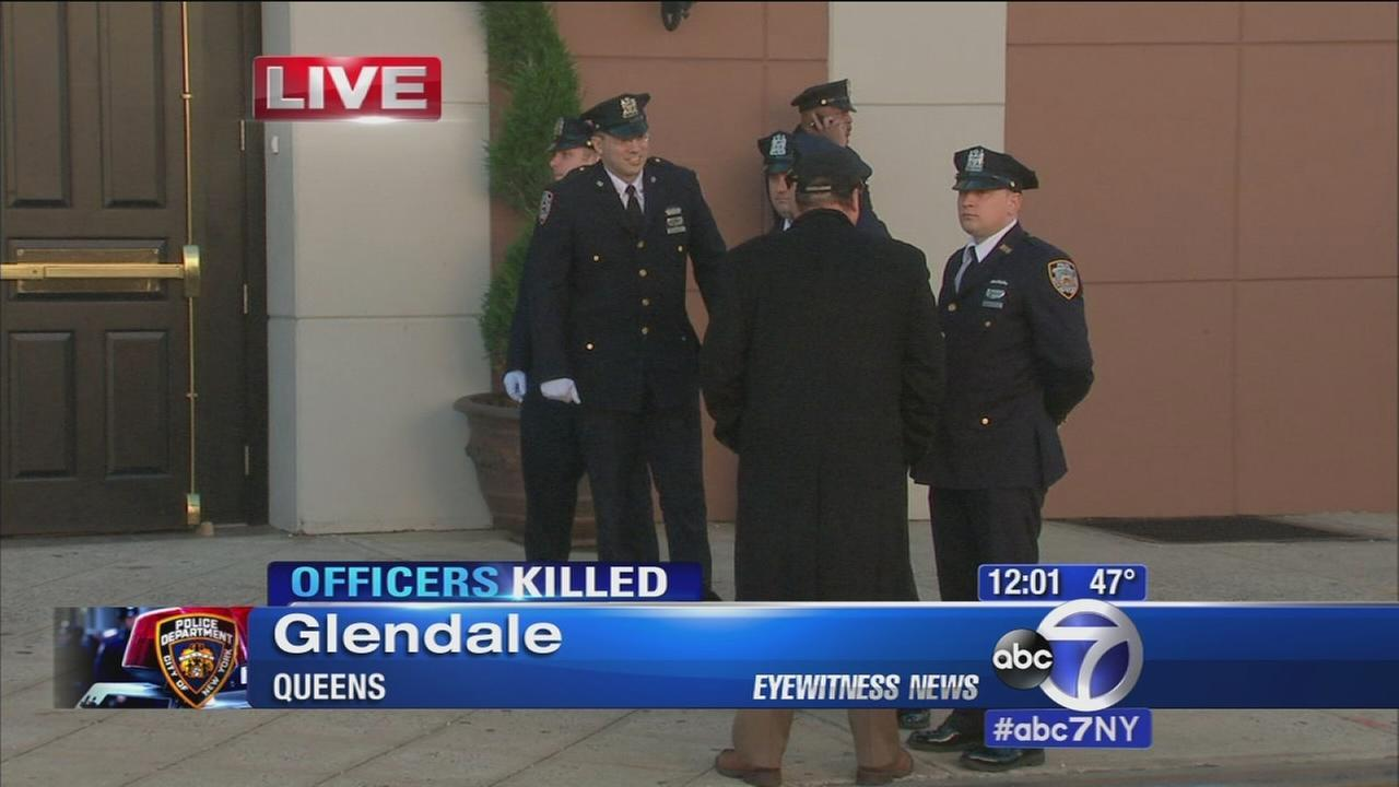 Fellow officers salute NY cop's flag-draped casket