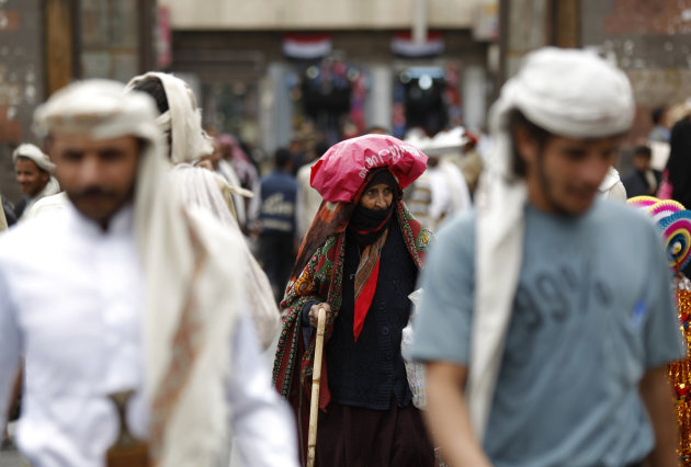 In this Sunday, Sept. 23, 2012 photo, an elderly Yemeni woman, center, walks on a street in the old city of Sanaa, Yemen. Women in Yemen are worse off now than a year ago, when they played a significant part in the country&#39;s revolution that promised political and economic change, an international aid agency has concluded. In a report released Monday, Oxfam International said four out of five Yemeni women claim their lives have worsened over the past 12 months. Faced with an intensifying humanitarian crisis, which has left a quarter of women between the ages of 15 and 49 acutely malnourished, they say they&#39;re struggling to feed their families and are unable to participate in the country&#39;s transition. (AP Photo/Hani Mohammed)