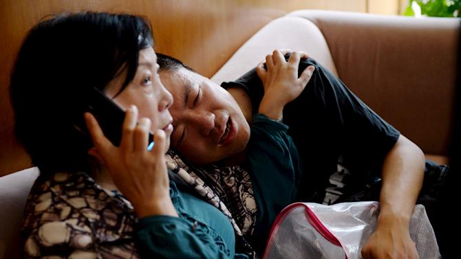 Family members of passengers on the ship which sank at the Jianli section of Yangtze River cry  in Shanghai