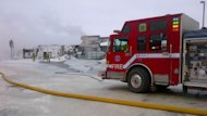 Edmonton firefighter had to contend with frigid temperature overnight as they battled a blaze that caused an estimated $12 million in damage.