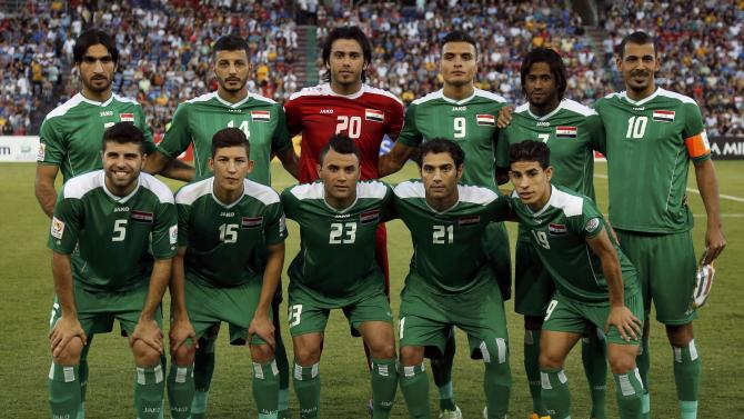 Iraq players line up for a team photo before the Asian Cup third-place playoff soccer match against UAE at the Newcastle Stadium in Newcastle