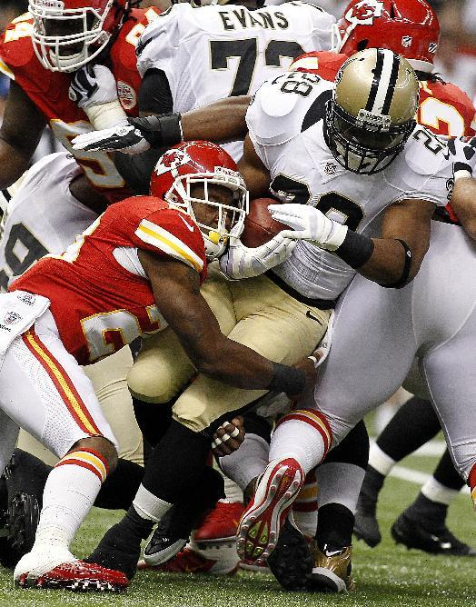 New Orleans Saints running back Pierre Thomas (23) carries as Kansas City Chiefs strong safety Eric Berry (29) tackles in the first half of an NFL football game in New Orleans, Sunday, Sept. 23, 2012. (AP Photo/Jonathan Bachman)