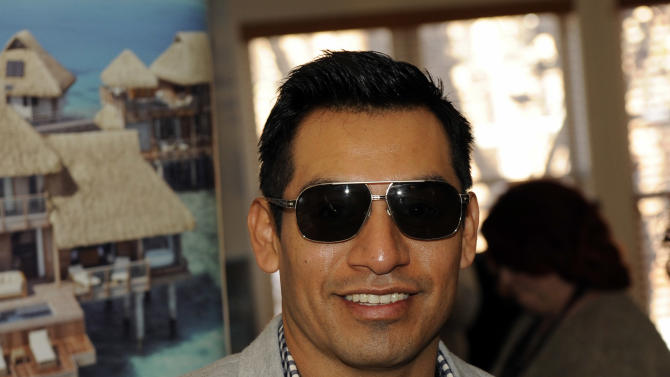 Actor Eloy Mendez wears Leisure Society sunglasses at the Fender Music lodge during the Sundance Film Festival on Sunday, Jan. 20, 2013, in Park City, Utah. (Photo by Jack Dempsey/Invision for Fender/AP Images)