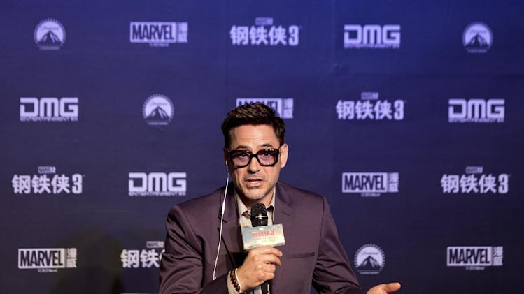 "U.S. actor Robert Downey Jr. speaks during a world premiere event of his new movie ""Iron Man 3"" at a Beijing hotel Saturday, April 6, 2013. (AP Photo/Andy Wong)"