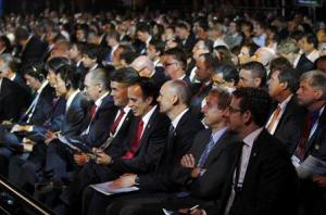 Members of soccer delegations attend the draw for the 2014 World Cup in Sao Joao da Mata