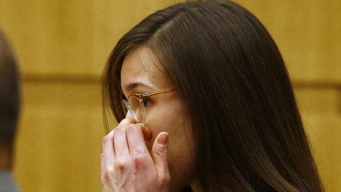 Jodi Arias reacts after she was found of guilty of first-degree murder in the gruesome killing of her one-time boyfriend, Travis Alexander, in their suburban Phoenix home, Wednesday, May 8, 2013, at Maricopa County Superior Court in Phoenix.  (AP Photo/The Arizona Republic, Rob Schumacher, Pool)