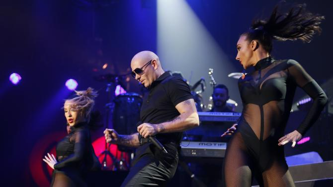 Recording artist Pitbull performs during the first-ever iHeartRadio Fiesta Latina at The Forum in Inglewood, California