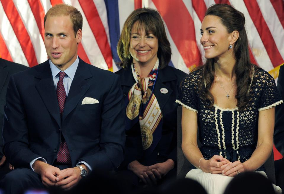 Prince William, the Duke of Cambridge, reacts to his introduction as Kate, Duchess of Cambridge, right, looks on during the Service Nation: Mission Serve Hiring Our Heroes Los Angeles job fair event at Sony Pictures Studios in Culver City, Calif., Sunday, July 10, 2011. (AP Photo/Chris Pizzello)