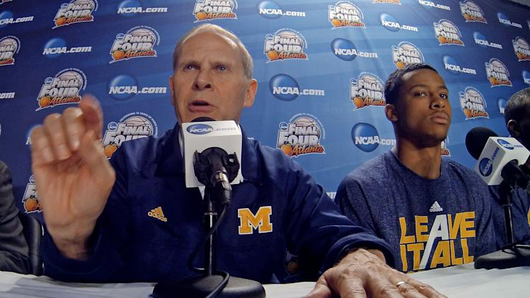 Michigan head coach John Beilein answers a question during a news conference for their NCAA Final Four tournament college basketball game Sunday, April 7, 2013, in Atlanta. Michigan plays Louisville in the championship game on Monday. (AP Photo/Tim Donnelly)
