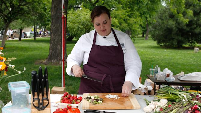 IMAGE DISTRIBUTED FOR CHICAGO CUTLERY - Chef Heather Terhune demonstrates knife skills with Chicago Cutlery and shares fresh, summer tips at the Green City Market on Saturday, June 22, 2013 in Chicago. (Scott Boehm / AP Images for Chicago Cutlery)
