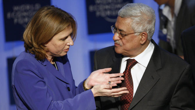 FILE - In this Jan. 25, 2007 file photo, Israeli Foreign Minister Tzipi Livni, left, and President of the Palestinian Authority Mahmoud Abbas talk after a plenary session on the Middle East during the World Economic Forum in Davos, Switzerland. The Palestinian president will invite Israeli politicians to the West Bank to try to make sure peacemaking is on the new government's agenda, a senior official said Thursday Jan. 24, 2013,  as a top Israeli hard-liner proposed sidelining the polarizing issue.(AP Photo/Keystone/Alessandro della Valle, File)