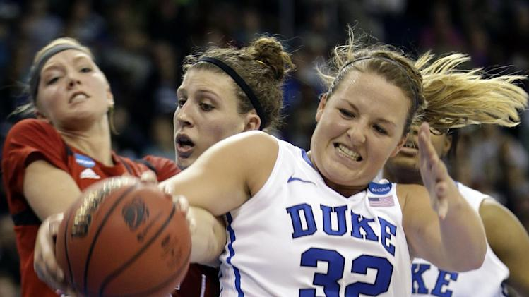 Duke guard Tricia Liston (32) struggles with Nebraska forward Jordan Hooper , center,  and Nebraska forward Emily Cady, left, during the second half of a regional semifinal game of the women's NCAA college basketball tournament Sunday, March 31, 2013, in Norfolk, Va. Duke won 53-45. (AP Photo/Steve Helber)