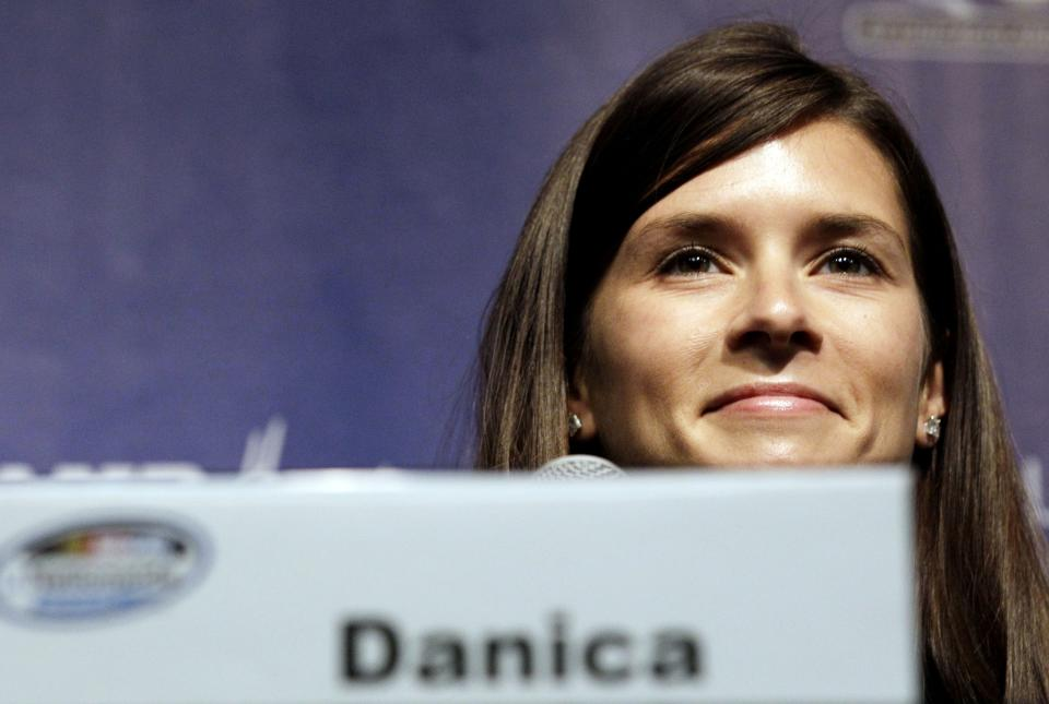 Danica Patrick smiles as she listens to questions at a news conference at Chicagoland Speedway in Joliet, Ill., Saturday, July 21, 2012. Patrick will attend Sunday's NASCAR  Nationwide Series auto race. (AP Photo/Nam Y. Huh)