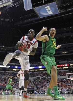 Smith leads Louisville to 77-69 victory over Ducks