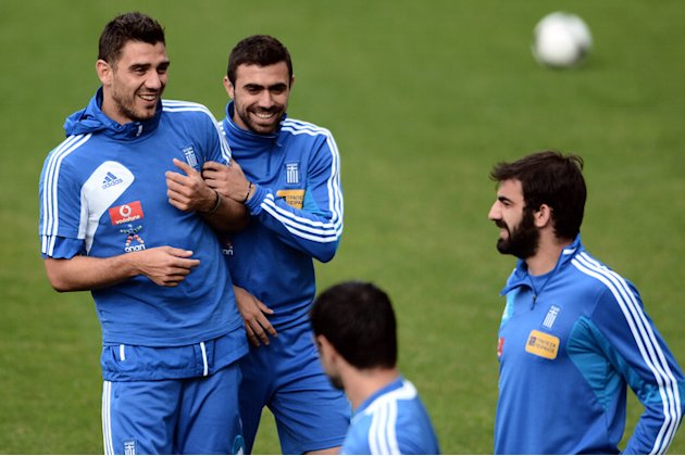 Greece' Midfielder Konstantinos Katsouranis (L) And Defender Giannis Maniatis (2ndL) Joke AFP/Getty Images
