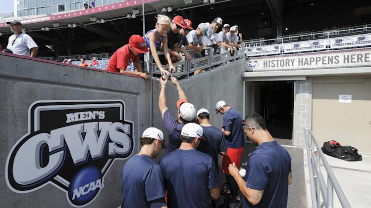 Stony Brook players sign autographs following team practice at TD Ameritrade Park in Omaha, Neb., Thursday, June 14, 2012. Stony Brook will play against UCLA on Friday in the opening game of the NCAA baseball College World Series. (AP Photo/Eric Francis)