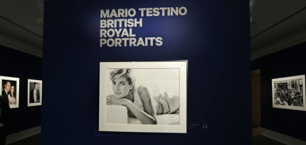 "A portrait of Princess Diana hangs as the lead image by photographer Mario Testino during the preview of his shows ""British Royal Portraits"" and ""In Your Face"" at the Museum of Fine Arts in Boston, Wednesday, Oct. 17, 2012. (AP Photo/Charles Krupa)"