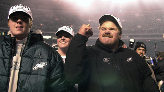 """FILE - In this Dec. 30, 2001 file photo, Philadelphia Eagles head coach Andy Reid, right, reacts to the crowd as he and his sons Garrett, left, and Britt, center, walk off the field after the Eagles beat the New York Giants 24-21, in Philadelphia. Garrett Reid was found dead Sunday, Aug. 5, 2012, in his room at training camp at Lehigh University. Police say """"there were no suspicious activities."""" (AP Photo/Chris Gardner, File)"""