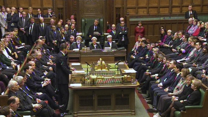"Britain's Prime Minister David Cameron, standing centre left, as he gives a tribute to Baroness Margaret Thatcher inside the House of Commons, in London, Wednesday April 10, 2013.   The British Parliament was convened for a special session Wednesday to pay tribute to former Prime Minister Margaret Thatcher, the ""Iron Lady"", who died aged 87 on Monday, following a stroke.  Thatcher will be afforded a full ceremonial funeral on upcoming April 17 at St. Paul's Cathedral, which will be attended by Queen Elizabeth II and various dignitaries from around the world. (AP Photo / PA Wire) UNITED KINGDOM OUT - NO SALES - NO ARCHIVES"