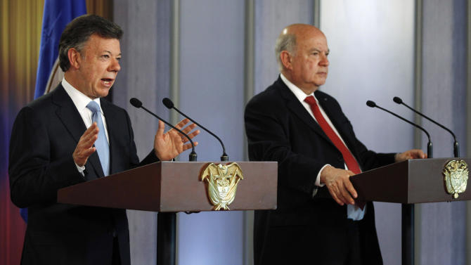 Colombia's President Juan Manuel Santos, left, speaks at a joint press conference with OAS chief Jose Miguel Insulza, right, about a regional study on the illicit drug trade, presented by Insulza to Santos at the Presidential Palace in Bogota, Colombia, Friday, May 17, 2013. The  $2.2 million study which emphasizes drug abuse as primarily a public health issue, makes no firm recommendations, instead suggesting several possible ways to stem the illicit drug trade, which has fueled violent crime and corruption and even destabilized governments. (AP Photo/Fernando Vergara)