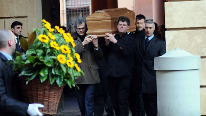 Pallbearers carry the coffin of Claudio Abbado in Bologna, Italy, Tuesday, Jan. 21, 2014. Claudio Abbado, a star in the great generation of Italian conductors revered for developing a rapport with members of the world's leading orchestras while still allowing them their independence, died Monday. He was 80. Abbado died at home in Bologna after a long illness, said Raffaella Grimaudo, spokeswoman for the Bologna mayor's office. Abbado made his debut in 1960 at La Scala in his home city of Milan and went on to be its music director for nearly 20 years. Among his many other positions were as music director of the Vienna State Opera, the Berlin Philarmonic and the London Symphony Orchestra and as principal guest conductor of the Chicago Symphony Orchestra. (AP Photo/Gianfilippo Oggioni, Lapresse)
