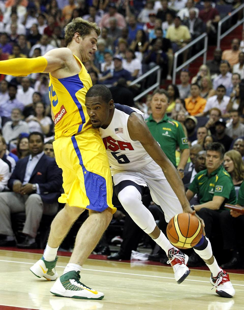 Team USA guard Kevin Durant, right, tries to get past Brazil's Tiago Splitter during the first half of an Olympic men's exhibition basketball game, Monday, July 16, 2012, in Washington. (AP Photo/Alex Brandon)