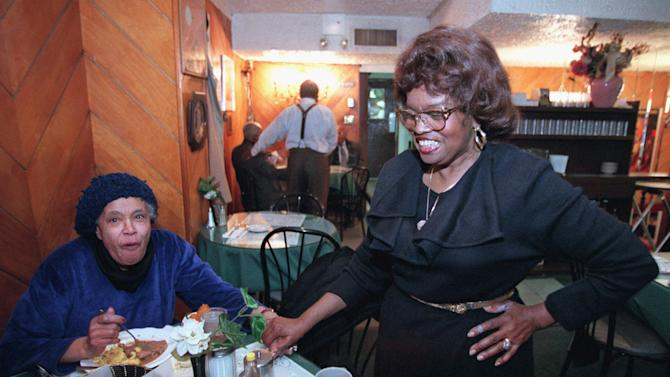 "FILE- In this Jan. 17, 1996 file photo, the Self-described ""Queen of Soul Food"" Sylvia Woods, right, greets patron Carrie Haynes-Madsen at her restaurant, ""Sylvia's,"" in the Harlem neighborhood of New York. Wood died in Mount Vernon, N.Y. on Thursday, July 19, 2012. She was 86. (AP Photo/Kathy Willens, File)"