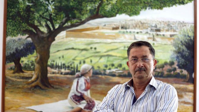 Prominent Jordanian political analyst and government critic Labib Kamhawi poses for a portrait in his office in Amman, Jordan, Wednesday, Aug. 15, 2012. Kamhawi said Wednesday that he may face prosecution and even jail for inciting revolt and defaming Jordan's King Abdullah II, but denied any wrongdoing and vowed he will fight back. The affair started when Kamhawi made comments on a TV talk show a few weeks ago that allegedly questioned the king's reform ambitions. (AP Photo/Mohammad Hannon)