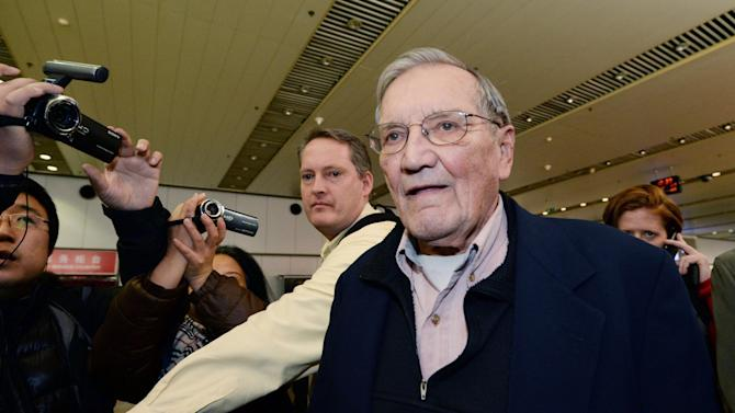 U.S. tourist Merrill Newman arrives at Beijing airport Saturday, Dec. 7, 2013 after being released by North Korea. North Korea deported Newman who was detained for more than a month, apparently ending the saga of his return to the North six decades after he advised South Korean guerrillas still loathed by Pyongyang. North Korea made the decision because the 85-year-old Newman had apologized for his alleged crimes during the Korean War and because of his age and medical condition, according to the North's official Korean Central News Agency. (AP Photo/Kyodo News) JAPAN OUT, CREDIT MANDATORY