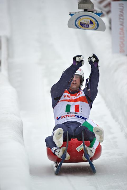 Italy's Christian Oberstolz hits the relay target in the Luge Team Relay event of the Luge World Cup in Latvias town of Sigulda on February 19, 2012. Russia won the race ahead of second-placed Austria