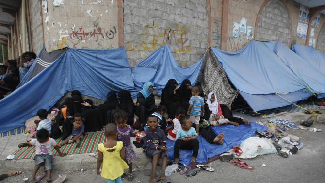 Eritrean female asylum seekers sit along with their children on the sidewalk in Sanaa, Yemen, Friday, June 20, 2014. Since April 29, over 200 Eritrean asylum seekers including women and children living on the streets of Sanaa wait to be resettled to a third country. For the first time since the World War II era, the number of people forced from their homes worldwide has surged past 50 million, the United Nations refugee agency said Friday. (AP Photo/Hani Mohammed)