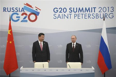 Russia's President Vladimir Putin meets with his Chinese counterpart Xi Jinping at the G20 Summit in Strelna near St. Petersburg