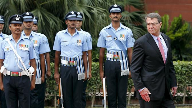 U.S. Defense Secretary Carter inspects an honour guard during his ceremonial reception in New Delhi