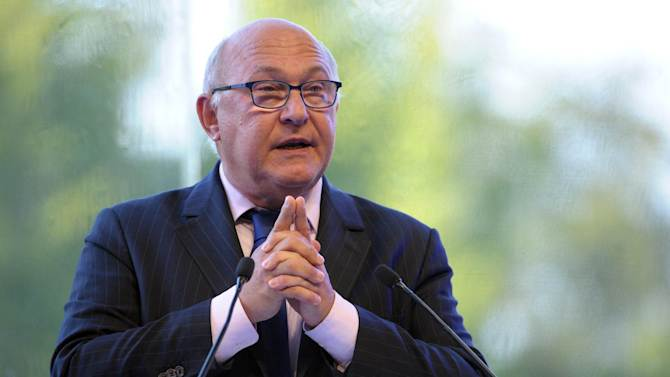 French Finance Minister Michel Sapin delivers a speech during the French employers' association Medef summer conference on August 28, 2014 in Jouy-en-Josas, near Paris