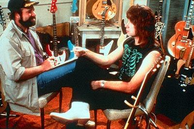 Filmmaker Marty DiBergi ( Rob Reiner ) talks with Nigel Tufnel ( Christopher Guest ) on the set of his definitive rockumentary in This Is Spinal Tap