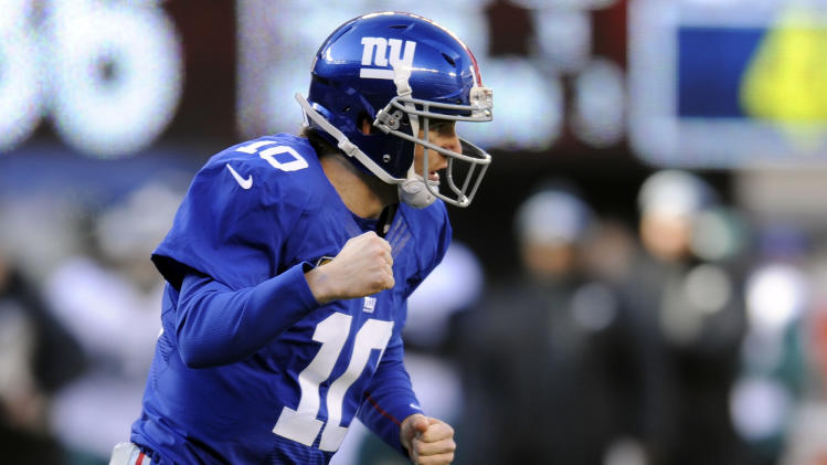New York Giants quarterback Eli Manning (10) reacts after throwing a toucdown pass to Rueben Randle during the first half of an NFL football game against the Philadelphia Eagles, Sunday, Dec. 30, 2012, in East Rutherford, N.J. (AP Photo/Bill Kostroun)