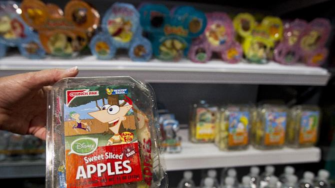 Disney's packed sliced sweet apples is held with other Disney food products, at the Newseum in Washington, Tuesday, June 5, 2012, during a news conference where first lady Michelle Obama and Walt Disney Company announced that Disney will become the first major media company to introduce new standards for food advertising on programming targeting kids and families.    (AP Photo/Manuel Balce Ceneta)