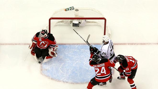 Martin Brodeur #30 Of The New Jersey Devils Makes A Save As Bryce Salvador #24 And Peter Harrold #10 Of The New Jersey  Getty Images